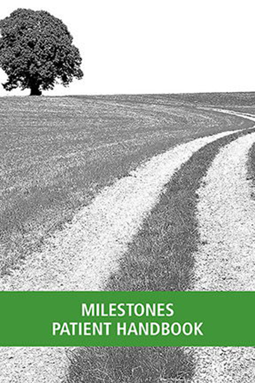 Milestones Handbook featuring a black-and-white photo of a gravel and grassy lane curving around to a leafy tree, with a green stripe across the bottom.